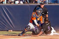 University of Washington Huskies Christian Jones (5)  is tagged out at home plate by Cal State Fullerton Titans Daniel Cope (10) at Goodwin Field on June 10, 2018 in Fullerton, California. The Huskies defeated the Titans 6-5. (Donn Parris/Four Seam Images)