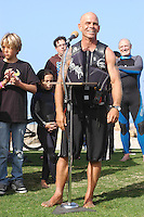 Tom Jones speaks to the crowd gathered to greet him upon arriving at Ocean Beach, Saturday, November 3 2007.  Tom began paddling his 14ft paddle board along the length of the California coastline on August 4th in Crescent City California.  He plans to be the first person to paddle the entire coast and hopes to bring awareness to the problem of plastic pollution in our oceans along the way.  Ocean Beach was the second to last leg of the trip which was due to finish near the Mexican border in Imperial Beach on Sunday, November 4 2007.