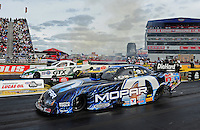 Sept. 5, 2011; Claremont, IN, USA: NHRA funny car driver Matt Hagan (near lane) races alongside Mike Neff during the US Nationals at Lucas Oil Raceway. Mandatory Credit: Mark J. Rebilas-