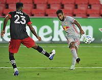 WASHINGTON, DC - SEPTEMBER 12: Cristian Casseres Jr. #23 of New York Red battles for the ball with Donovan Pines #23 of D.C. United during a game between New York Red Bulls and D.C. United at Audi Field on September 12, 2020 in Washington, DC.