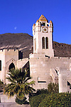 Scotty's Castle<br />Death Valley California<br />The 56-foot-high Chimes Tower, begun in 1927, was originally intended to store solar-heated water.  Perhaps inspired by the acoustics of the Castle's canyon setting, Johnson had it redesigned to include a clock and a set of Deagan chimes that could be controlled from any of four locations.  Like many of the complex's elements, its architectural style is part Spanish Revival, part fantasy.  Unlike the rest of the Castle's wood-frame-and-stucco buildings, however, the Chimes Tower is built of poured-in-place concrete.   The separate building at foreground is the complex's powerhouse, which dates from 1929; its concrete walls are rusticated to resemble medieval fitted stone blocks.  The Chimes Tower and various other portions of the Castle remained uncompleted when the Depression forced Johnson to halt construction in 1931.  Subsequent financial and legal problems prevented him from resuming the work; he died in 1948.  Walter Scott continued to live at the castle until his death six years later.  The property was purchased in 1970 by the National Park Service.