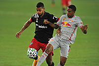 WASHINGTON, DC - SEPTEMBER 12: Ola Kamara #9 of D.C. United battles for the ball with Kyle Duncan #6 of New York Red Bulls during a game between New York Red Bulls and D.C. United at Audi Field on September 12, 2020 in Washington, DC.