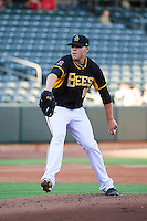 Justin Thomas (10) of the Salt Lake Bees delivers a pitch to the plate against the Tacoma Rainiers in Pacific Coast League action at Smith's Ballpark on July 8, 2014 in Salt Lake City, Utah.  (Stephen Smith/Four Seam Images)