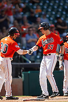 Sam Houston State Bearkats first baseman Ryan O'Hearn #27 is greeted by teammate Anthony Azar #20 during the NCAA baseball game against the Texas Tech Red Raiders on March 1, 2014 during the Houston College Classic at Minute Maid Park in Houston, Texas. The Bearkats defeated the Red Raiders 10-6. (Andrew Woolley/Four Seam Images)
