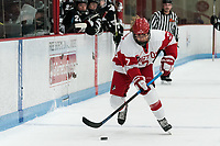 BOSTON, MA - JANUARY 11: Jesse Compher #7 of Boston University brings the puck forward during a game between Providence College and Boston University at Walter Brown Arena on January 11, 2020 in Boston, Massachusetts.