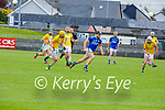 Michael Leane of Kerry on a solo run as Meath's Keith Keoghan and Éamonn Ó'Donnchadha close down on him, in the National hurling league in Austin Stack Park on Sunday