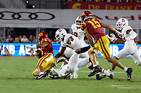 LOS ANGELES, CA - SEPTEMBER 11: Kyu Blu Kelly #17 and Levani Damuni #3 of the Stanford Cardinal tackle Vavae Malepeai #6 of the USC Trojans during a game between University of Southern California and Stanford Football at Los Angeles Memorial Coliseum on September 11, 2021 in Los Angeles, California.