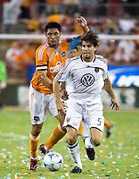 D.C. United defender Dejan Jakovic (5) shields the ball from Houston Dynamo forward Brian Ching (25).  Houston Dynamo defeated D.C. United 4-3 at Robertson Stadium in Houston, TX on August 1, 2009.