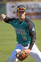 Coastal Carolina Chanticleers shortstop Brain Pruitt #6 throwing in the outfield before a game against the North Carolina State Wolfpack at BB&T Coastal Field on February 26, 2012 in Myrtle Beach, SC.  Coastal Carolina defeated N.C. State 3-2. (Robert Gurganus/Four Seam Images)