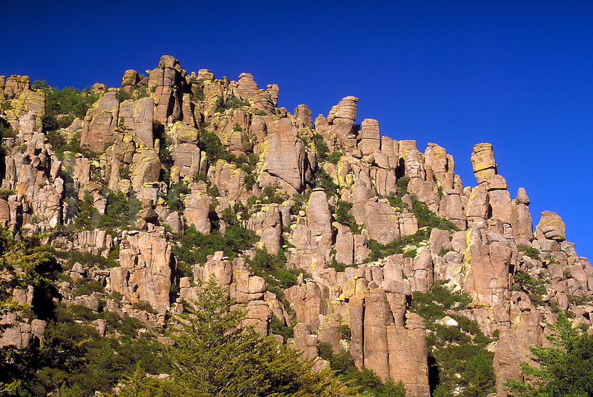 "Chiricahua National Monument, the """"Wonderland of Rocks"""", is in the Chiricahua Mountains at an elevation ranging from 5,100 to 7,800 ft. The mountains features rock spires, stone columns, and huge balanced rocks sculpted by millions of years of erosion on."