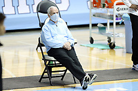 CHAPEL HILL, NC - FEBRUARY 24: Head coach Roy Williams of North Carolina watches warmups before a game between Marquette and North Carolina at Dean E. Smith Center on February 24, 2021 in Chapel Hill, North Carolina.