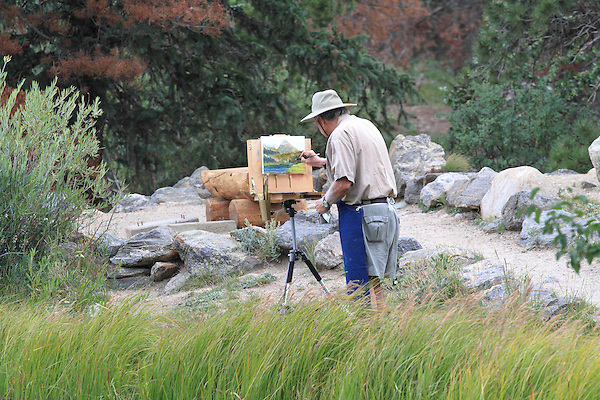 Caucasian elderly artist painting along Sprague Lake, Rocky Mountain National Park, west of Estes Park, Colorado. .  John offers private photo tours in Denver, Boulder and throughout Colorado. Year-round.