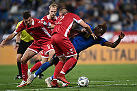 8th September 2021; Mapei Stadium, Città del Tricolore, Reggio Emilia, Italy: FIFA World Cup 2022 qualification, Italy versus Lithuania:  Linas Klimavicius with a heay challenge on Moise Kean watched by Edgaras Utkus