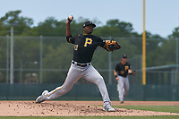 Pittsburgh Pirates pitcher Yerry De Los Santos (83) during a Minor League Spring Training game against the Baltimore Orioles on April 21, 2021 at Pirate City in Bradenton, Florida.  (Mike Janes/Four Seam Images)