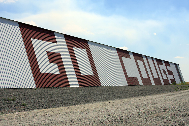 """GO COUGS"" sign painted on a barn along side highway 26 between Othello, Washington, and Washtucna, Washington, in Eastern Washington."
