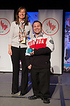 Calgary, AB - June 5 2014 - Karl Ludwig receives his Paralympic ring from Erin Kelly, of Suncor/Petro-Canada, during the Celebration of Excellence Paralympic Ring Reception in Calgary. (Photo: Matthew Murnaghan/Canadian Paralympic Committee)