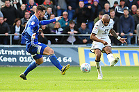 Andre Ayew of Swansea City shot is blocked by Sean Morrison of Cardiff City during the Sky Bet Championship match between Swansea City and Cardiff City at the Liberty Stadium in Swansea, Wales, UK. Sunday 27 October 2019