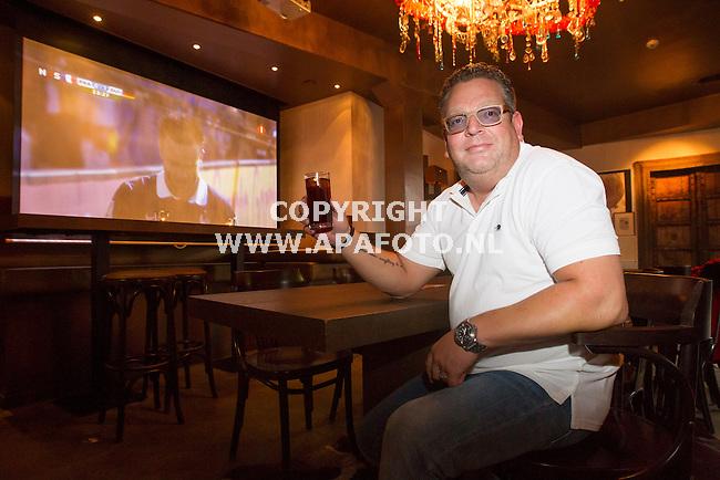 OOSTERBEEK 040714 Uitbater Hans Monster in cafe Mimi's in Oosterbeek. Na elven mag er buiten geen voetbal gekeken worden.<br /> Foto Jorrit Knuvelder - APA Foto