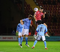 Lincoln City's Tom Hopper wins a high ball under pressure from Manchester City U21's Callum Doyle<br /> <br /> Photographer Chris Vaughan/CameraSport<br /> <br /> EFL Papa John's Trophy - Northern Section - Group E - Lincoln City v Manchester City U21 - Tuesday 17th November 2020 - LNER Stadium - Lincoln<br />  <br /> World Copyright © 2020 CameraSport. All rights reserved. 43 Linden Ave. Countesthorpe. Leicester. England. LE8 5PG - Tel: +44 (0) 116 277 4147 - admin@camerasport.com - www.camerasport.com