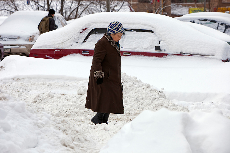 Moscow, Russia, 23/02/2010..A woman makes her way through snowdrifts in central Moscow after record amounts of snow fell over the weekend, the heaviest in the Russian capital for nearly 50 years.
