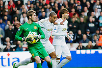 Sunday, 23 November 2012<br /> <br /> Pictured: David de Gea of Manchester United, Ashley Williams of Swansea City  and Michu of Swansea City <br /> <br /> Re: Barclays Premier League, Swansea City FC v Manchester United at the Liberty Stadium, south Wales.