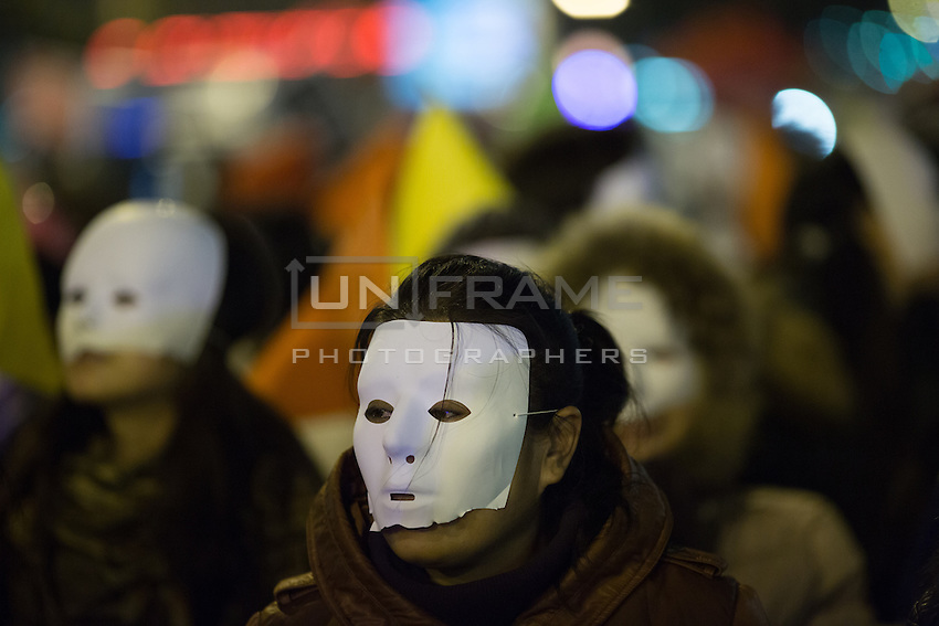 Women of Chinese descent concealed by masks, representing  sex workers in Paris, seen on Boulevard de la Villette, take part in a demonstration on the International Day to End Violence Against Sex Workers. Chinese sex workers in Paris, who are usually here without legal papers, often experience violence and harassment on the streets from clients and even police. Paris, France. Dec. 17, 2014