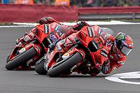 29th August 2021; Silverstone Circuit, Silverstone, Northamptonshire, England; MotoGP British Grand Prix, Race Day; Ducati Lenovo Team rider Francesco Bagnaia on his Ducati Desmosedici GP21 ahead of his team mate Jack Miller