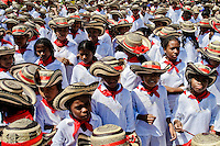 Colombian children, wearing a traditional Caribbean clothes and the Vueltiao hats, dance Cumbia during the Carnival in Barranquilla, Colombia, 25 February 2006. The Carnival of Barranquilla is a unique festivity which takes place every year during February or March on the Caribbean coast of Colombia. A colourful mixture of the ancient African tribal dances and the Spanish music influence - cumbia, porro, mapale, puya, congo among others - hit for five days nearly all central streets of Barranquilla. Those traditions kept for centuries by Black African slaves have had the great impact on Colombian culture and Colombian society. In November 2003 the Carnival of Barranquilla was proclaimed as the Masterpiece of the Oral and Intangible Heritage of Humanity by UNESCO.