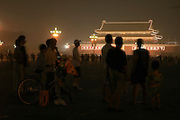 Silhouettes of people at night with the Temple of Heavenly Peace in the background, Tiananmen Square, Beijing, China.