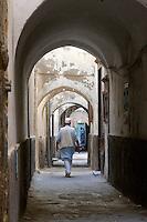 Tripoli, Libya - Man Walking in Medina Passageway