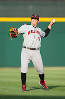 Chris McGuiness (19) of the Indianapolis Indians warms up in the outfield prior to the game against the Charlotte Knights at BB&T Ballpark on May 23, 2014 in Charlotte, North Carolina.  The Indians defeated the Knights 15-6.  (Brian Westerholt/Four Seam Images)