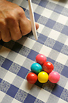 Gum ball pool on blue and white tablecloth.