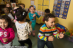 Education Preschool 3 year olds group music and dance time children dancing and jumping to songs