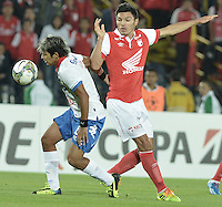 BOGOTÁ-COLOMBIA-11-02-2014. Daniel Torres (Der.) jugador del Independiente Santa Fe de Colombia, disputa el balón con Silvio Torales (Izq.) jugador del Nacional de Paraguay, durante partido entre Independiente Santa Fe y Nacional de la segunda fase, grupo 4, de la Copa Bridgestone Libertadores en el estadio Nemesio Camacho El Campin, de la ciudad de Bogota./ Daniel Torres (R) player of Independiente Santa Fe of Colombia, vies for the ball with Silvio Torales (L) player of Nacional of Paraguay, during a match between Independiente Santa Fe and Nacional for the second phase, group 4, of the Copa Bridgestone Libertadores in the Nemesio Camacho El Campin in Bogota city.  Photo: VizzorImage/ Gabriel Aponte /Staff