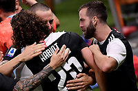 Adrien Rabiot of Juventus celebrates with team mates Leonardo Bonucci and Miralem Pjanic after scoring the goal of 0-1 during the Serie A football match between AC Milan and Juventus FC at stadio San Siro in Milan ( Italy ), July 7th, 2020. Play resumes behind closed doors following the outbreak of the coronavirus disease. <br /> Photo Federico Tardito / Insidefoto