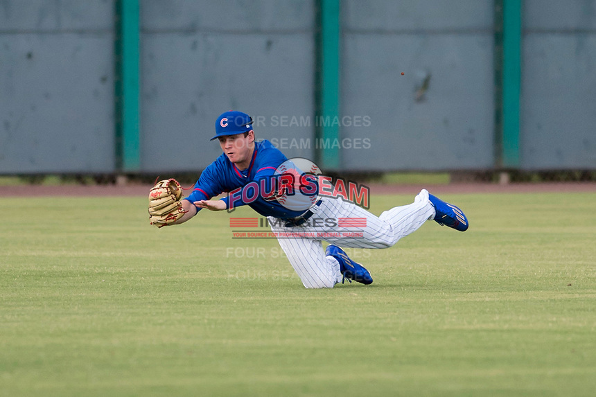 AZL Cubs 2 center fielder Cole Roederer (34) makes a diving catch during an Arizona League game against the AZL White Sox at Sloan Park on July 13, 2018 in Mesa, Arizona. The AZL Cubs 2 defeated the AZL White Sox 6-4. (Zachary Lucy/Four Seam Images)