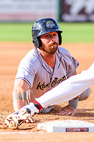 Kane County Cougars catcher Francis Christy (8) dives back to first base during game one of a Midwest League doubleheader against the Wisconsin Timber Rattlers on June 23, 2017 at Fox Cities Stadium in Appleton, Wisconsin.  Kane County defeated Wisconsin 4-3. (Brad Krause/Four Seam Images)
