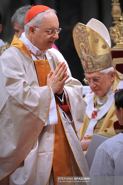 Pope Benedict XVI (L) gives his cardinal ring to Italian Mauro Piacenza (C) during the Eucharistic celebration with the new cardinals on November 21, 2010 at St Peter's basilica at The Vatican. 24 Roman Catholic prelates joined the day before the Vatican's College of Cardinals, the elite body that advises the pontiff and elects his successor upon his death.