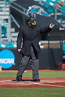Home plate umpire Andrew Glenn asks for help on a call during the NCAA baseball game between the Western Carolina Catamounts and the Kennesaw State Owls at Springs Brooks Stadium on February 22, 2020 in Conway, South Carolina. The Owls defeated the Catamounts 12-0.  (Brian Westerholt/Four Seam Images)