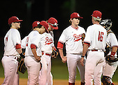 Lake Mary Rams coach Ed Nuss (16) talks with the team including (L-R) Jacob Corso (24), Brett Brubaker (19), Brendan Rodgers (3), Nikolas Kovach (12), Bradley Nenna (10) game against the Lake Brantley Patriots on April 2, 2015 at Allen Tuttle Field in Lake Mary, Florida.  Lake Brantley defeated Lake Mary 10-5.  (Mike Janes Photography)