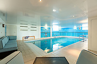 BNPS.co.uk (01202) 558833. <br /> Pic: TailorMade/AshleyFaull/BNPS<br /> <br /> Pictured: The indoor pool in the £6m mansion which has now been demolished. <br /> <br /> A wealthy homeowner has made the 'brave' decision to demolish his £6m seaside mansion that has its own indoor pool, gym and cinema. <br /> <br /> Ashley Faull has flattened the 20-year-old luxury house to build nine new flats to meet the increasing demand for housing that has led to a surge in property prices.<br /> <br /> The apartments will be priced between £1.495m to £2.8m.<br /> <br /> The now ruined four-storey and 19-room home sits on a half-an-acre plot that backs on to Poole Harbour and overlooks exclusive Sandbanks in Dorset.