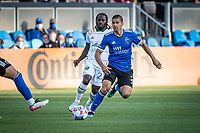 SAN JOSE, CA - MAY 15: Yimmi Chara #23 of the Portland Timbers chases Luciano Abecasis #2 of the San Jose Earthquakes during a game between San Jose Earthquakes and Portland Timbers at PayPal Park on May 15, 2021 in San Jose, California.