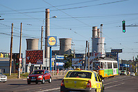 Romania. Iași County. Iași. Traffic, shopping centers such as Lidl, Praktiker or Kaufhof, and a thermal power station. Cars, taxis and a yellow streetcar on the road. The shopping centers were build after the romanian revolution on the old industrial site's ruins. The thermal power stationis is running with only half of its full capacity. Lidl Stiftung & Co. KG is a German global discount supermarket chain. A thermal power station is a power plant in which the prime mover is steam driven. Water is heated, turns into steam and spins a steam turbine which drives an electrical generator. After it passes through the turbine, the steam is condensed in a condenser and recycled to where it was heated; this is known as a Rankine cycle. The greatest variation in the design of thermal power stations is due to the different fossil fuel resources generally used to heat the water. Some prefer to use the term energy center because such facilities convert forms of heat energy into electrical energy. Certain thermal power plants also are designed to produce heat energy for industrial purposes. Globally, fossil fueled thermal power plants produce a large part of man-made CO2 emissions to the atmosphere. Iași (also referred to as Iasi, Jassy or Iassy) is the largest city in eastern Romania and the seat of Iași County. Located in the Moldavia region, Iași has traditionally been one of the leading centres of Romanian social life. The city was the capital of the Principality of Moldavia from 1564 to 1859, then of the United Principalities from 1859 to 1862, and the capital of Romania from 1916 to 1918. 7.06.15© 2015 Didier Ruef