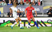 Saint Paul, MN - SEPTEMBER 03: Tatiana Pinto #11 of Portugal and Carli Loyd #10 of the United States during their 2019 Victory Tour match versus Portugal at Allianz Field, on September 03, 2019 in Saint Paul, Minnesota.