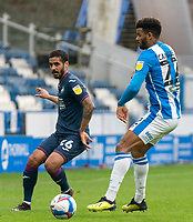 20th February 2021; The John Smiths Stadium, Huddersfield, Yorkshire, England; English Football League Championship Football, Huddersfield Town versus Swansea City; Kyle Naughton of Swansea City plays a pass down the line past Fraizer Campbell