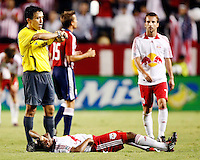 Head referee Mauricio Navarro keeps a close eye on the time as NY Red Bulls midfielder, Dane Richards(19) lays on the ground at the end of the game. Chivas USA  took on the NY Red Bulls on June 28, 2008 at the Home Depot Center in Carson, CA. The game ended in a 1-1 tie.