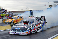 Mar. 10, 2012; Gainesville, FL, USA; NHRA funny car driver Courtney Force (near) burns out alongside Jeff Arend during qualifying for the Gatornationals at Auto Plus Raceway at Gainesville. Mandatory Credit: Mark J. Rebilas-