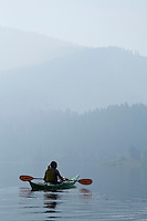 Kayaking on Slide Lake in the Gros Ventre mountain range, Wyoming