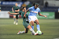 # 12 Elise Weber of St. Louis Athletica  slides for the ball against #12 Chioma Igwe  of the Chicago Reds. Athletica beat the Red Stars 2-0...