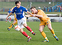 COWDENBEATH'S LIAM CUSACK HOLDS OFF DUMBARTON'S ALAN LITHGOW